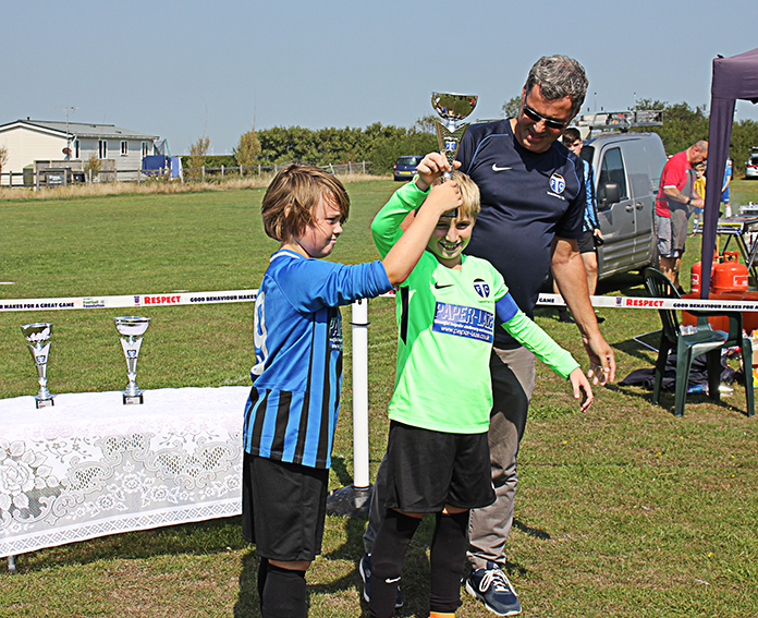 TFC Chairman, Andy Davidson, presents the Under 11s' trophy to Tankerton Colts